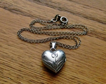 Vintage Sterling Silver Engraved Heart Locket Necklace with an Antiqued Finish