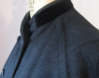 25% off with coupon HOLIDAYHAPPINESS2. 1960s Bromleigh charcoal grey wool coat with velvet collar. Double breasted. Medium.