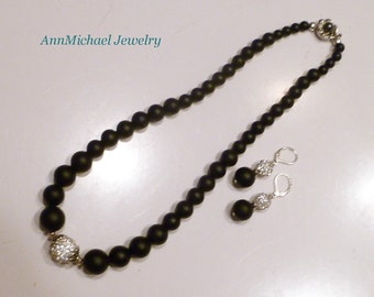 Matte black onyx necklace and earring set, pave crystal accents, fancy push clasp, grey faux pearl, rhinestone accents, sterling silver