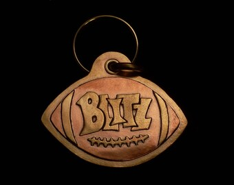 Sports themed pet tag