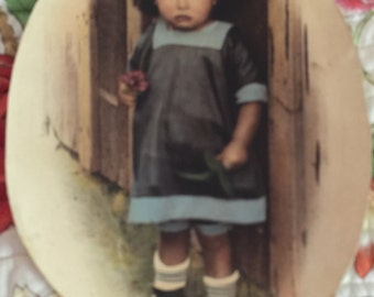 Antique Oval Picture of a little Girl holding Violets High Top Button Up Shoes about 1910