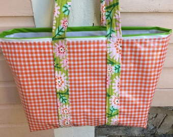 Large retro reversible oilcloth tote bag in orange gingham and green stripes