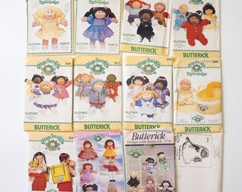 """Vintage Lot of 12 Butterick Cabbage Patch Kids Sewing Patterns / Clothes for 16"""" Dolls, Bed Carrier and Back Pack / Most in Factory Folds"""