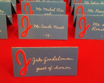 Monogrammed place cards with your choice of colors and includes calligraphy