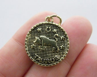 2 Taurus pendants antique gold tone