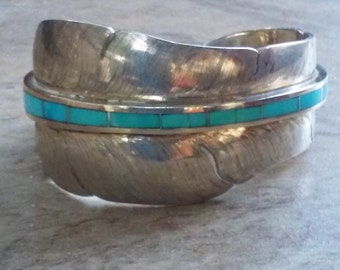 Sterling silver feather cuff with turquoise inlay