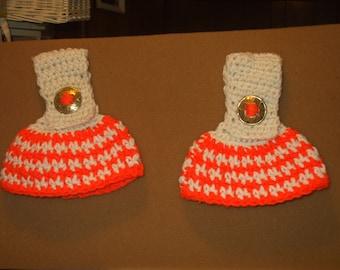 2 crocheted towel holders