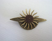 Antiqued brass sun brooch pin with round copper center