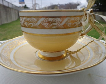 Grosvenor China~ England~ Butterscotch , White With Gold Designs, Cup & Saucer