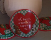 "Rare! FACTORY MISTAKE! 1986 Hallmark ""Baby's First Christmas"" Satin Ornament. Disks NOT attached to ball, shrink wrap sleeve is missing!"
