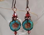 Aqua swirl tropical flower earrings