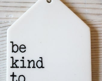 porcelain wall tag screenprinted text be kind to yourself.