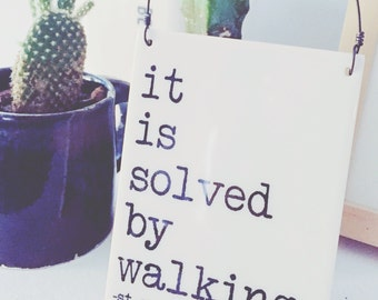 porcelain wall tile screenprinted text it is solved by walking. -st.augustine