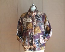 vintage 1990's cheetah print warm up jacket / windbreaker / jogging suit attire / silk / baggy fit  / oversized