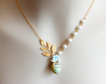 Sweet Owl and Leafy Branch Necklace. yellow porcelain owl with gold leaf pendant. garden collection. wedding. gift for her