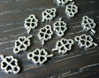 Destash (12) Mini Shamrock Four-Leaf Clover silverplated lucky charm - for pendants, jewelry making, crafts, scrapbooking