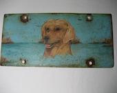 vintage hand painted dog portrait done on metal
