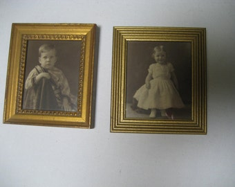 pair of miniature vintage photo portraits in gold painted wooden frames