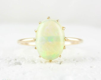 Vintage Opal Solitaire Ring, Conversion 9 Carat Gold Victorian Oval Shape Cabochon Cut White Opal Single Stone Claw Set Ring.