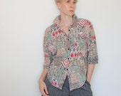 Vintage 80's button down, 3/4 length dolman sleeves, light shoulder pads, earth tones & red, abstract geometric tribal pattern - Medium