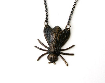 dark gold fly necklace . fly in the ointment