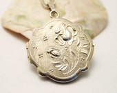Vintage locket. Sterling silver locket. Flower locket