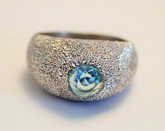 Blue topaz and sterling silver ring. UK size N. US size 6 /2