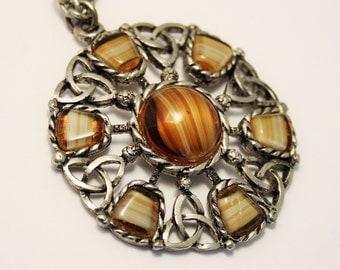 Vintage Celtic style pendant. Brown glass pendant.