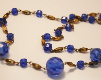Vintage blue glass bead necklace.