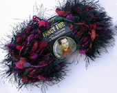 Lion Brand Fancy Fur Novelty Yarn in Strawberry Fields, Black Eyelash with Red, Green, Pink Pompoms, Great for Christmas, Scarves and More