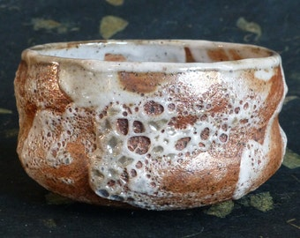Brown Stoneware Tea Bowl with Chrysanthemum Foot Design and White Volcanic Glaze  artist George Watson