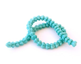 50 Czech Glass Flowers - Baby Bell Flower Beads, Opaque Turquoise Blue, 4 x 6 mm, 8 Inch Strand