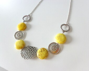 Yellow gems and silver necklace