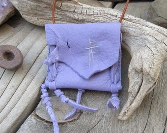 Leather pouch...Midnight Lightning...This Wisdom Pouch is made out of a beautiful purple deerskin leather and features hand carved symbols.