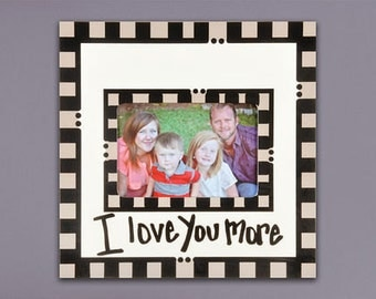 11x11 I love you more frame.  Holds 4x6 picture
