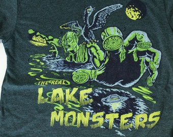 The Real Lake Monsters of Lake Champlain Unisex T-Shirt on American Apparel Black Aqua