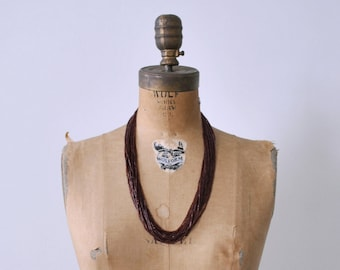 1920's maroon beaded necklace. art deco. glass bead. red brown. 20's strand necklace.