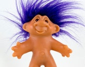 1986 Dam Troll Doll, Bright purple Hair, Brown eyes with black pupils, Looks like he is talking or lopsided smile, Signed