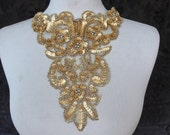 Cute  beaded and   embroidered  applique   gold color  1 pieces listing 7 1/2 inches wide at the neck  9 1/2 inches long from shoulder down
