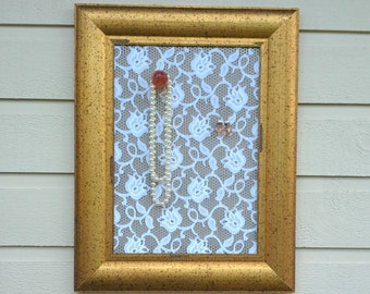 Framed Earring holder made from a gold speckled wood frame with a lace covered magnetic insert for photos, jewelry storage and memo display