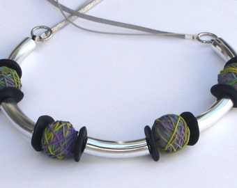 Festive necklace with silver plated tube beads and colorful polymer clay beads