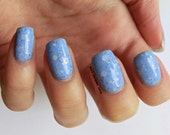 "Nail polish - ""Hole in the sky"" silver dot and periwinkle glitter in a light blue base"