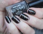 "Nail polish - ""Fruitcake in August?""  silver, gold and rainbow glitter in a dark brown base"