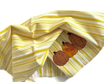 Deep yellow white stripe dish towel  three pumpkin appliqués