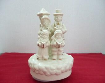 "Musical Revolving Porcelain Carolers Figurine ""We Wish You A Merry Christmas"" - Revolving Carolers Music Box"