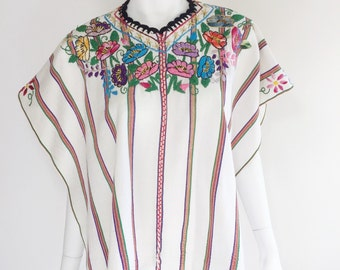 Vintage huipil from Patzún, Guatemala. Handwoven white stripe textile with embroidered floral design. 1960s.