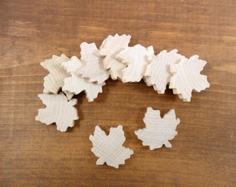 "25 Wood Maple Leaves 1 3/8"" H x 1 1/4"" W x 3/16"" Unfinished Wood Maple Leaf"
