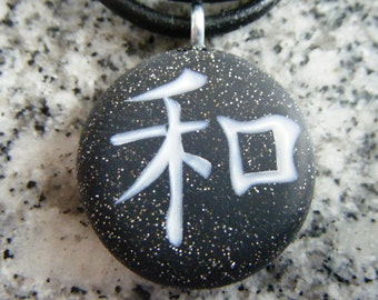 PEACE Japanese kanji symbol hand carved on a polymer clay Starry black color background. Pendant comes with a FREE 3mm necklace