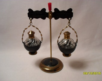 Unusual Vintage Salt and Pepper Shakers with Metal Tabletop Hanging Rack