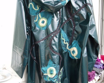 Raincoat... turquoise - teal... XS